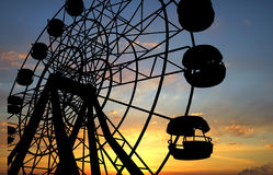 Ferris Wheel. Over orange sunset Stock Photos