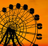 Ferris Wheel. Over orange sunset Stock Photo