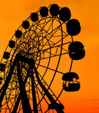 Ferris Wheel. Over orange sunset Royalty Free Stock Images