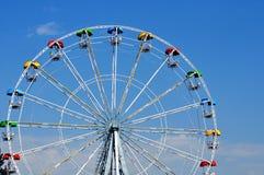 Ferris Wheel. A colourful ferris wheel against a deep blue sky Stock Photos