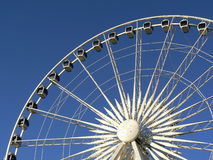 Ferris wheel. Photo of a big white ferris wheel against the blue sky Royalty Free Stock Photography