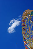 Ferris wheel. Funfair ferris wheel over blue summer sky. Above only the sky and moon Stock Images