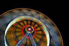 Ferris wheel. Night view of a ferris wheel in motion Stock Image