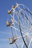 Ferris Wheel. Empty Ferris Wheel on a bright sunny day with blue sky Royalty Free Stock Photography