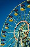 Ferris wheel. On blue sky in amusement park Stock Images