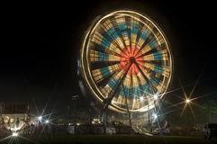 Ferris Wheel. In motion with lights in 8 point stars Royalty Free Stock Photo