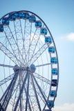 Ferris wheel above blue sky background Royalty Free Stock Photo