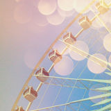 Ferris wheel with abstract bokeh in retro effect Royalty Free Stock Photos