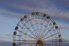 Ferris wheel against the background of the evening sky Stock Images