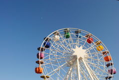 Ferris wheel against blue skies Stock Photo