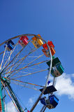 Ferris Wheel Against a Blue Sky Stock Images