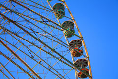 Ferris wheel against a blue sky Royalty Free Stock Photos