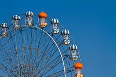 Ferris wheel against blue sky Stock Photo