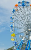 Ferris wheel against the blue sky Stock Images
