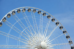Ferris wheel against a blue sky Royalty Free Stock Images