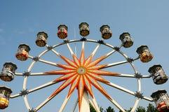 Ferris wheel against blue sky Stock Photos
