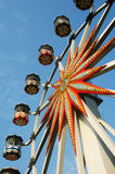 Ferris wheel against blue sky Stock Photography