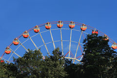 Ferris Wheel against blue sky. Stock Photos