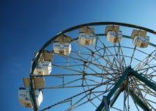 Ferris wheel against blue sky. Stock Photo