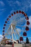 Ferris wheel against blue sky. Ferris wheel at amusement park against blue sky Stock Photo