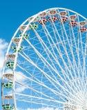 Ferris wheel against the blue sky Stock Photos