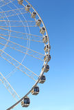 Ferris wheel against a blue sky Stock Image
