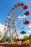 Ferris wheel against blue sky background in city park Royalty Free Stock Photography