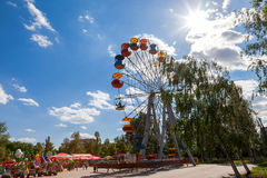 Ferris wheel against blue sky background in city park Stock Photography
