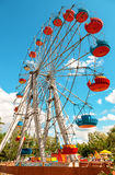 Ferris wheel against blue sky background in city park in summer Royalty Free Stock Photography