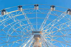 Ferris wheel against blue sky background Royalty Free Stock Photography