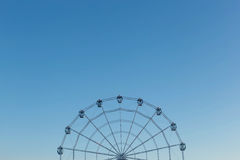 Ferris wheel against blue sky background Royalty Free Stock Photos