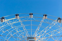 Ferris wheel against blue sky background Royalty Free Stock Image