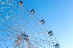 Ferris wheel against blue sky background stock photo