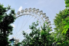 Ferris wheel against a blue sky. Bottom view. Stock Image