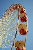 Ferris Wheel against a Blue Sky. Ferris Wheel cars against a bright blue sky Royalty Free Stock Images