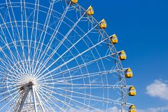 Ferris wheel against the blue sky. In the park in nature Royalty Free Stock Image