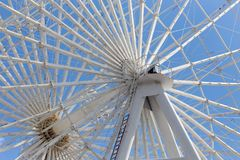 Ferris wheel against the blue sky. In the park in nature Stock Image
