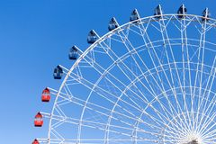 Ferris wheel against the blue sky. In the park in nature Stock Photography
