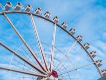 Ferris wheel against a blue sky royalty free stock photo