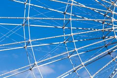 Ferris wheel against the blue sky. Photo of an abstract texture Royalty Free Stock Image