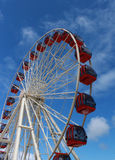 Ferris Wheel against blue sky. Ferris wheel ride at amusement park set against blue sky Stock Photography