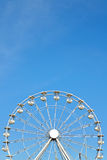 Ferris wheel against blue sky, space for text Stock Photo