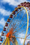 Ferris wheel against a blue sky on a sunny day Stock Photography