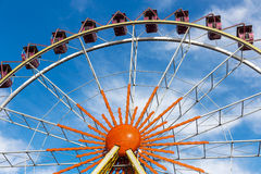 Ferris wheel against a blue sky on a sunny day Stock Images
