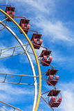 Ferris wheel against a blue sky on a sunny day Royalty Free Stock Photography