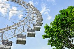 Ferris wheel against a blue sky. Bottom view. Stock Photography