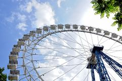 Ferris wheel against a blue sky. Bottom view. Royalty Free Stock Photography