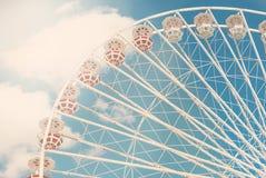 Ferris wheel against the blue sky toned photo Stock Image