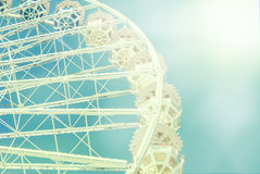 Ferris wheel against the blue sky toned photo Stock Images