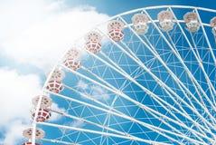 Ferris wheel against the blue sky toned photo Stock Photos